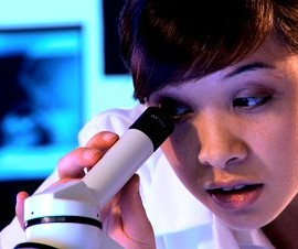 stock-footage-young-western-oriental-medical-student-using-a-microscope